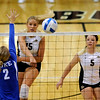 University of Colorado freshman Nichole Lindow spikes the ball past Duke senior Becci Burling while CU freshman Hannah Walker, right, watches on Saturday, Aug. 28, at the CU vs. Duke volleyball match at the Coors Event Center on the CU campus in Boulder.<br /> Jeremy Papasso/ Camera