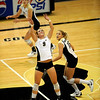 University of Colorado junior Alyssa Valentine, front, serves the ball up for freshman Nichole Lindow on Saturday, Aug. 28, at the CU vs. Duke volleyball match at the Coors Event Center on the CU campus in Boulder.<br /> Jeremy Papasso/ Camera