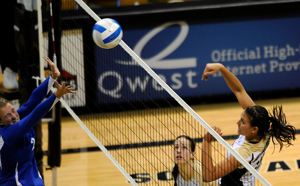 University of Colorado junior Anicia Santos goes for a kill over Duke senior Becci Burling, left, on Saturday, Aug. 28, at the CU vs. Duke volleyball match at the Coors Event Center on the CU campus in Boulder.<br /> Jeremy Papasso/ Camera