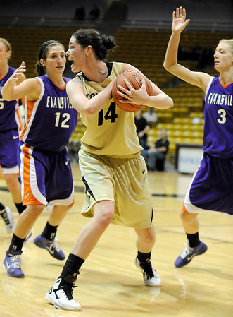 """University of Colorado sophomore Meagan Malcolm-Peck yells for a time-out after rebounding the ball on Friday, Nov. 26, during a basketball game against the University of Evansville at the Coors Events Center on the CU campus. CU defeated Evansville 55-53.<br /> For more photos go to  <a href=""""http://www.dailycamera.com"""">http://www.dailycamera.com</a><br /> Photo by Jeremy Papasso"""