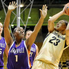 """University of Colorado sophomore Chucky Jeffery takes a jump shot over Evansville freshman Khristian Hart on Friday, Nov. 26, during a basketball game against the University of Evansville at the Coors Events Center on the CU campus. CU defeated Evansville 55-53.<br /> For more photos go to  <a href=""""http://www.dailycamera.com"""">http://www.dailycamera.com</a><br /> Photo by Jeremy Papasso"""