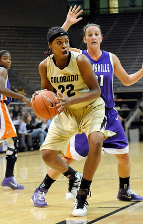 "University of Colorado senior Brittany Spears drives towards the hoop on Friday, Nov. 26, during a basketball game against the University of Evansville at the Coors Events Center on the CU campus. CU defeated Evansville 55-53.<br /> For more photos go to  <a href=""http://www.dailycamera.com"">http://www.dailycamera.com</a><br /> Photo by Jeremy Papasso"