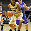 """University of Colorado senior Brittany Spears drives towards the hoop on Friday, Nov. 26, during a basketball game against the University of Evansville at the Coors Events Center on the CU campus. CU defeated Evansville 55-53.<br /> For more photos go to  <a href=""""http://www.dailycamera.com"""">http://www.dailycamera.com</a><br /> Photo by Jeremy Papasso"""