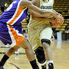 """University of Colorado freshman Ashley Wilson drives the ball past Evansville junior Briyana Blair on Friday, Nov. 26, during a basketball game against the University of Evansville at the Coors Events Center on the CU campus. CU defeated Evansville 55-53.<br /> For more photos go to  <a href=""""http://www.dailycamera.com"""">http://www.dailycamera.com</a><br /> Photo by Jeremy Papasso"""