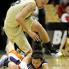 "University of Colorado sophomore Chucky Jeffery jumps over Evansville senior Stephanie Bamberger while trying to steal the ball on Friday, Nov. 26, during a basketball game against the University of Evansville at the Coors Events Center on the CU campus. CU defeated Evansville 55-53.<br /> For more photos go to  <a href=""http://www.dailycamera.com"">http://www.dailycamera.com</a><br /> Photo by Jeremy Papasso"