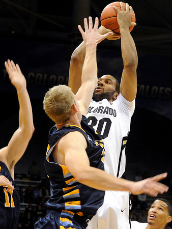 "University of Colorado's Carlon Brown takes a shot over Torrey Udall during a game against Fort Lewis College on Friday, Nov. 11, at the Coors Event Center on the CU campus in Boulder. CU won the game 85-57. For more photos of the game go to  <a href=""http://www.dailycamera.com"">http://www.dailycamera.com</a><br /> Jeremy Papasso/ Camera"