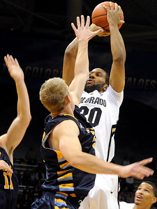 University of Colorado's Carlon Brown takes a shot over Torrey Udall during a game against Fort Lewis College on Friday, Nov. 11, at the Coors Event Center on the CU campus in Boulder. CU won the game 85-57. For more photos of the game go to www.dailycamera.com Jeremy Papasso/ Camera