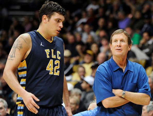 "Fort Lewis College Head Coach Bob Hofman talks with Matt Morris during a game against the University of Colorado on Friday, Nov. 11, at the Coors Event Center on the CU campus in Boulder. CU won the game 85-57. For more photos of the game go to  <a href=""http://www.dailycamera.com"">http://www.dailycamera.com</a><br /> Jeremy Papasso/ Camera"