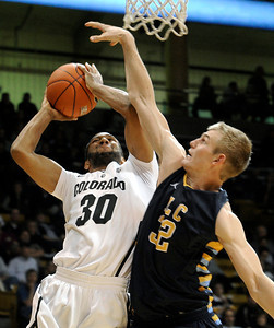 University of Colorado's Carlon Brown taskes a shot over Torrey Udall during a game against Fort Lewis College on Friday, Nov. 11, at the Coors Event Center on the CU campus in Boulder. CU won the game 85-57. For more photos of the game go to www.dailycamera.com Jeremy Papasso/ Camera