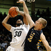 "University of Colorado's Carlon Brown taskes a shot over Torrey Udall during a game against Fort Lewis College on Friday, Nov. 11, at the Coors Event Center on the CU campus in Boulder. CU won the game 85-57. For more photos of the game go to  <a href=""http://www.dailycamera.com"">http://www.dailycamera.com</a><br /> Jeremy Papasso/ Camera"