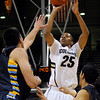 "University of Colorado's Spencer Dinwiddie takes a shot over Fort Lewis defenders during a game against Fort Lewis College on Friday, Nov. 11, at the Coors Event Center on the CU campus in Boulder. CU won the game 85-57. For more photos of the game go to  <a href=""http://www.dailycamera.com"">http://www.dailycamera.com</a><br /> Jeremy Papasso/ Camera"