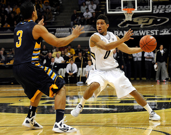 "University of Colorado's Askia Booker jukes Marcus Ayala during a game against Fort Lewis College on Friday, Nov. 11, at the Coors Event Center on the CU campus in Boulder. CU won the game 85-57. For more photos of the game go to  <a href=""http://www.dailycamera.com"">http://www.dailycamera.com</a><br /> Jeremy Papasso/ Camera"