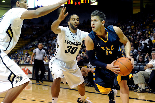 """University of Colorado's Carlon Brown, No. 30, tries to steal the ball from Mike Matthews during a game against Fort Lewis College on Friday, Nov. 11, at the Coors Event Center on the CU campus in Boulder. CU won the game 85-57. For more photos of the game go to  <a href=""""http://www.dailycamera.com"""">http://www.dailycamera.com</a><br /> Jeremy Papasso/ Camera"""