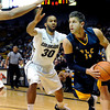 "University of Colorado's Carlon Brown, No. 30, tries to steal the ball from Mike Matthews during a game against Fort Lewis College on Friday, Nov. 11, at the Coors Event Center on the CU campus in Boulder. CU won the game 85-57. For more photos of the game go to  <a href=""http://www.dailycamera.com"">http://www.dailycamera.com</a><br /> Jeremy Papasso/ Camera"
