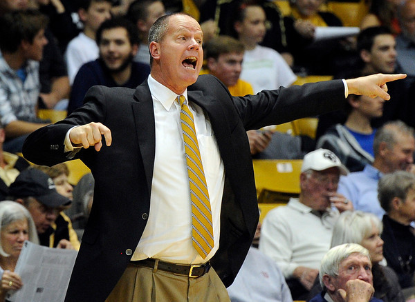 """University of Colorado Head Coach Tad Boyle argues a call with the referee during a game against Fort Lewis College on Friday, Nov. 11, at the Coors Event Center on the CU campus in Boulder. CU won the game 85-57. For more photos of the game go to  <a href=""""http://www.dailycamera.com"""">http://www.dailycamera.com</a><br /> Jeremy Papasso/ Camera"""