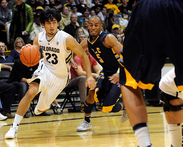 University of Colorado's Sabatino Chen drives past Matt Billups, of Fort Lewis, during a game against Fort Lewis College on Friday, Nov. 11, at the Coors Event Center on the CU campus in Boulder. CU won the game 85-57. For more photos of the game go to www.dailycamera.com Jeremy Papasso/ Camera