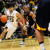 "University of Colorado's Sabatino Chen drives past Matt Billups, of Fort Lewis, during a game against Fort Lewis College on Friday, Nov. 11, at the Coors Event Center on the CU campus in Boulder. CU won the game 85-57. For more photos of the game go to  <a href=""http://www.dailycamera.com"">http://www.dailycamera.com</a><br /> Jeremy Papasso/ Camera"