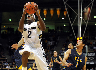 University of Colorado's Shannon Sharpe drives to the hoop past Matthew Mazarei, No. 1, of Fort Lewis, during a game against Fort Lewis College on Friday, Nov. 11, at the Coors Event Center on the CU campus in Boulder. CU won the game 85-57. For more photos of the game go to www.dailycamera.com Jeremy Papasso/ Camera