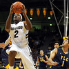 "University of Colorado's Shannon Sharpe drives to the hoop past Matthew Mazarei, No. 1, of Fort Lewis, during a game against Fort Lewis College on Friday, Nov. 11, at the Coors Event Center on the CU campus in Boulder. CU won the game 85-57. For more photos of the game go to  <a href=""http://www.dailycamera.com"">http://www.dailycamera.com</a><br /> Jeremy Papasso/ Camera"
