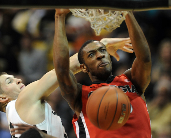 Donte Williams of Georgia, dunks past Austin Dufault of Colorado,  during the first half of the November 28, 2011 game in Boulder, Co.<br />  November 28, 2011 / Cliff Grassmick