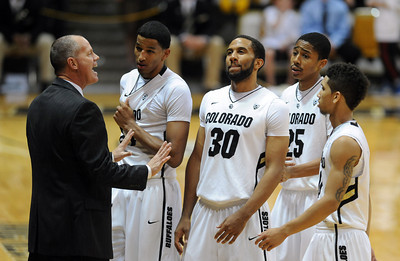CU coach, Tad Boyle, tries to settle down the players late in the Georgia game. November 28, 2011 / Cliff Grassmick