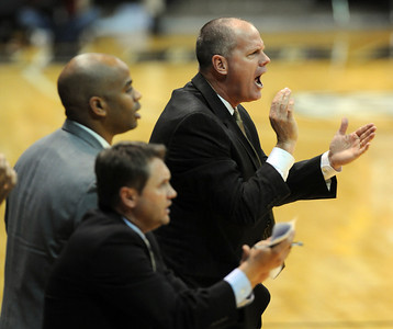 CU coach, Tad Boyle, right, is happy with the effort against Georgia.   November 28, 2011 / Cliff Grassmick
