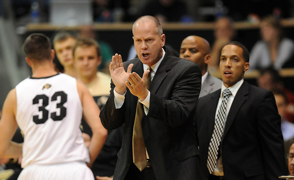 Head Coach, Tad Boyle, encourages the Buffs in the Georgia game.<br /> <br />  November 28, 2011 / Cliff Grassmick