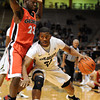Jremy Adams of Colorado, dribbles into Sherrard Brantley of Georgia,  during the first half of the November 28, 2011 game in Boulder, Co.<br /> <br /> <br />  November 28, 2011 / Cliff Grassmick