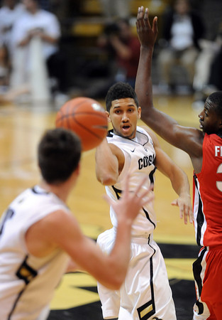 Askia Book dishes the ball to Shane Harris -Tunks of CU against Georgia.<br /> <br />  November 28, 2011 / Cliff Grassmick