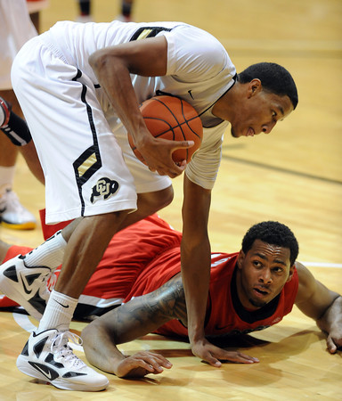 Andre Roberson, left, of Colorado, makes a critical offensive rebound late in the game as Marcus Thornton of Georgia tries to get the ball,  during the second half of the November 28, 2011 game in Boulder.<br /> November 28, 2011 / Cliff Grassmick