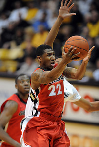 Gerald Robinson of Georgia, drives past Andre Roberson of Colorado,  during the first half of the November 28, 2011 game in Boulder, Co. November 28, 2011 / Cliff Grassmick