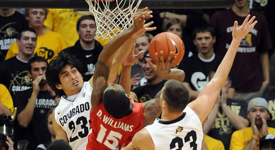 Sabatino Chen, left, and Austin Dufault try to block Donte Williams of Georgia.   November 28, 2011 / Cliff Grassmick