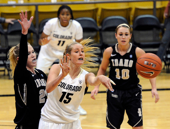 "University of Colorado's Julie Seabrook passes the ball on Sunday, Dec. 4, during a game against the University of Idaho at the Coors Event Center on the CU campus in Boulder. CU won the game 68-59. For more photos of the game go to  <a href=""http://www.dailycamera.com"">http://www.dailycamera.com</a><br /> Jeremy Papasso/ Camera"
