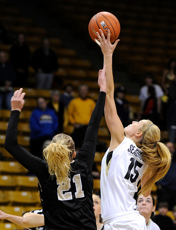 "University of Colorado's Julie Seabrook wins the tip off against Idaho's Jessica Graham on Sunday, Dec. 4, during a game against the University of Idaho at the Coors Event Center on the CU campus in Boulder. CU won the game 68-59. For more photos of the game go to  <a href=""http://www.dailycamera.com"">http://www.dailycamera.com</a><br /> Jeremy Papasso/ Camera"