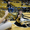"University of Colorado band members Robin Newcome, left, Ian Bruns, middle, and Mitchell Block play the Super Duper Tuba Cheer on Sunday, Dec. 4, during a game against the University of Idaho at the Coors Event Center on the CU campus in Boulder. CU won the game 68-59. For more photos of the game go to  <a href=""http://www.dailycamera.com"">http://www.dailycamera.com</a><br /> Jeremy Papasso/ Camera"