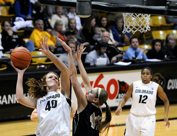 """University of Colorado's Rachel Hargis takes a shot over Idaho's Ashley Walters on Sunday, Dec. 4, during a game against the University of Idaho at the Coors Event Center on the CU campus in Boulder. CU won the game 68-59. For more photos of the game go to  <a href=""""http://www.dailycamera.com"""">http://www.dailycamera.com</a><br /> Jeremy Papasso/ Camera"""