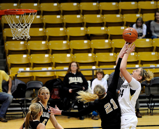 "University of Colorado's Jen Reese takes a shot over Idaho's Jessica Graham on Sunday, Dec. 4, during a game against the University of Idaho at the Coors Event Center on the CU campus in Boulder. CU won the game 68-59. For more photos of the game go to  <a href=""http://www.dailycamera.com"">http://www.dailycamera.com</a><br /> Jeremy Papasso/ Camera"