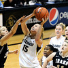 """University of Colorado's Julie Seabrook drives to the hoop over Idaho's Alyssa Charlston on Sunday, Dec. 4, during a game against the University of Idaho at the Coors Event Center on the CU campus in Boulder. CU won the game 68-59. For more photos of the game go to  <a href=""""http://www.dailycamera.com"""">http://www.dailycamera.com</a><br /> Jeremy Papasso/ Camera"""