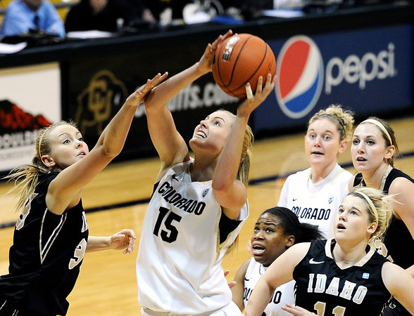 "University of Colorado's Julie Seabrook drives to the hoop over Idaho's Alyssa Charlston on Sunday, Dec. 4, during a game against the University of Idaho at the Coors Event Center on the CU campus in Boulder. CU won the game 68-59. For more photos of the game go to  <a href=""http://www.dailycamera.com"">http://www.dailycamera.com</a><br /> Jeremy Papasso/ Camera"