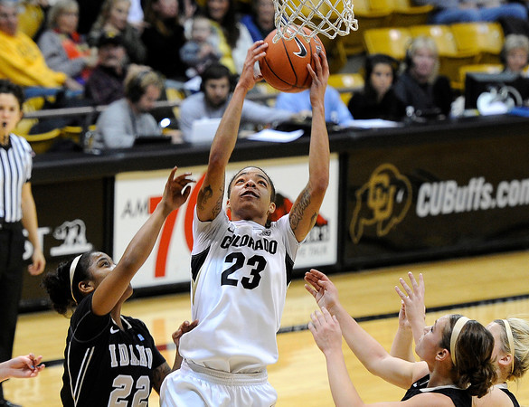 "University of Colorado's Chucky Jeffery snags a rebound over Idaho's Ganeaya Rogers, No. 22, on Sunday, Dec. 4, during a game against the University of Idaho at the Coors Event Center on the CU campus in Boulder. CU won the game 68-59. For more photos of the game go to  <a href=""http://www.dailycamera.com"">http://www.dailycamera.com</a><br /> Jeremy Papasso/ Camera"