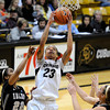 """University of Colorado's Chucky Jeffery snags a rebound over Idaho's Ganeaya Rogers, No. 22, on Sunday, Dec. 4, during a game against the University of Idaho at the Coors Event Center on the CU campus in Boulder. CU won the game 68-59. For more photos of the game go to  <a href=""""http://www.dailycamera.com"""">http://www.dailycamera.com</a><br /> Jeremy Papasso/ Camera"""