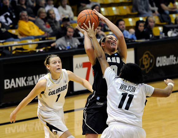 "University of Colorado's Brittany Wilson goes for a block on Idaho's Keri Arendse on Sunday, Dec. 4, during a game against the University of Idaho at the Coors Event Center on the CU campus in Boulder. CU won the game 68-59. For more photos of the game go to  <a href=""http://www.dailycamera.com"">http://www.dailycamera.com</a><br /> Jeremy Papasso/ Camera"