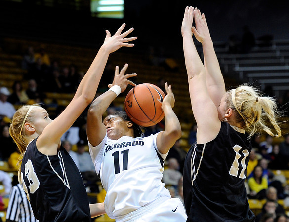 """University of Colorado's Brittany Wilson gets fouled by Idaho's Alyssa Charlston, left, on Sunday, Dec. 4, during a game against the University of Idaho at the Coors Event Center on the CU campus in Boulder. CU won the game 68-59. For more photos of the game go to  <a href=""""http://www.dailycamera.com"""">http://www.dailycamera.com</a><br /> Jeremy Papasso/ Camera"""
