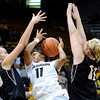 "University of Colorado's Brittany Wilson gets fouled by Idaho's Alyssa Charlston, left, on Sunday, Dec. 4, during a game against the University of Idaho at the Coors Event Center on the CU campus in Boulder. CU won the game 68-59. For more photos of the game go to  <a href=""http://www.dailycamera.com"">http://www.dailycamera.com</a><br /> Jeremy Papasso/ Camera"