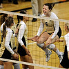 University of Colorado freshman Hannah Walker, middle, jumps for joy after winning a set on Saturday, Sept. 25, in a volleyball match against the University of Kansas at the Coors Events Center on the CU Boulder campus. CU defeated Kansas 25-23.25-23,13-25,22-25,15-13.<br /> Jeremy Papasso/ Camera