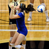 University of Colorado freshman Nikki Lindow scores a point for the Buff's over the top of Kansas junior Nicole Tate on Saturday, Sept. 25, in a volleyball match against the University of Kansas at the Coors Events Center in Boulder. CU defeated Kansas 25-23.25-23,13-25,22-25,15-13.<br /> Jeremy Papasso/ Camera