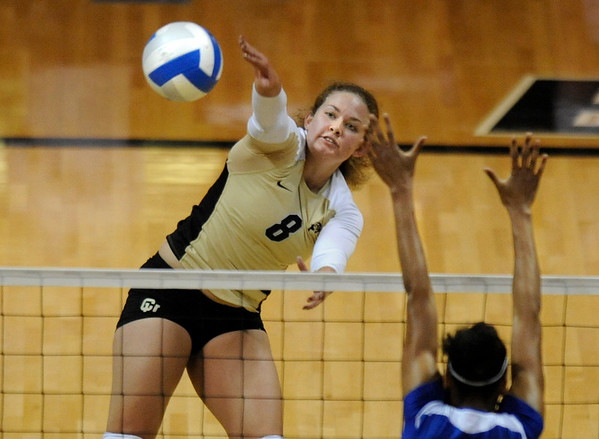 University of Colorado junior Richi Begelow goes for a kill over University of Kansas sophomore Tayler Tolefree on Saturday, Sept. 25, in a volleyball match against the University of Kansas at the Coors Events Center on the CU Boulder campus. CU defeated Kansas 25-23.25-23,13-25,22-25,15-13.<br /> Jeremy Papasso/ Camera