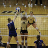 University of Colorado junior Anicia Santos blocks an attempted kill by Kansas freshman Caroline Jarmoc on Saturday, Sept. 25, in a volleyball match against the University of Kansas at the Coors Events Center in Boulder. CU defeated Kansas 25-23.25-23,13-25,22-25,15-13.<br /> Jeremy Papasso/ Camera