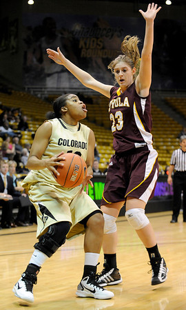 """University of Colorado freshman Brittany Wilson looks for an open teammate on Saturday, Nov. 27, during a basketball game against Loyola University Chicago at the Coors Events Center on the CU campus. CU defeated Loyola 65-34.<br /> For more photos go to  <a href=""""http://www.dailycamera.com"""">http://www.dailycamera.com</a><br /> Photo by Jeremy Papasso"""
