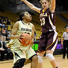 "University of Colorado freshman Brittany Wilson looks for an open teammate on Saturday, Nov. 27, during a basketball game against Loyola University Chicago at the Coors Events Center on the CU campus. CU defeated Loyola 65-34.<br /> For more photos go to  <a href=""http://www.dailycamera.com"">http://www.dailycamera.com</a><br /> Photo by Jeremy Papasso"